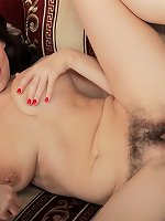 Agneta shows off her playful side in her blue blouse and orange skirt. Slowly undressing, her hairy pussy is shown off and her legs spread wide open. Her pink pussy lips and 38C breasts are amazing.