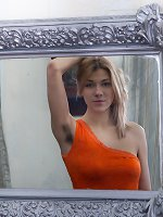 Alisia shows off her hairy pits early while curled up on the sofa. Stripping from her orange dress to her lingerie, her hairy pussy is shown off halfway through. She is sexy and playful as she strips.