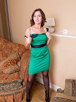 In her green dress and stockings, Vita is elegant. By halfway through the images, you can see her very hairy pussy and see her stretch her pink pussy lips. By the end you want to be with her all the time.